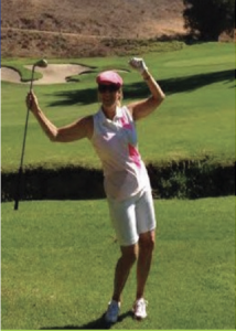 Female Client celebrating on the golf course