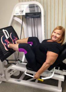 woman doing leg press while personal training