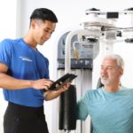 Personal trainer sharing client results with client on machine