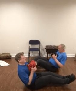 two men working out at home with a Virtual Personal Trainer