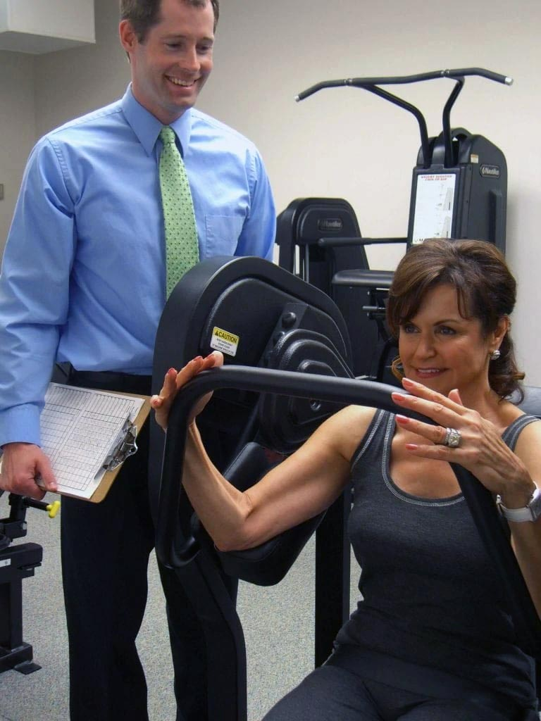 Matt Hedman coaching a female client at The Perfect Workout
