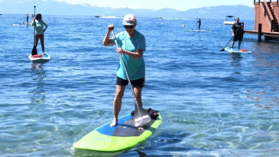 Virtual Strength Training Client on a stand up paddleboard in Walnut Creek, CA