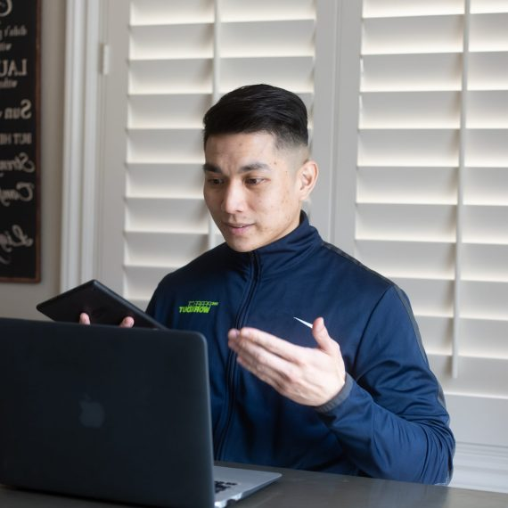virtual personal trainer on his laptop