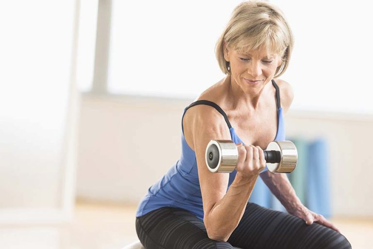 man strength training with a dumbbell