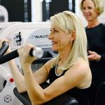 woman in her 60s strength training