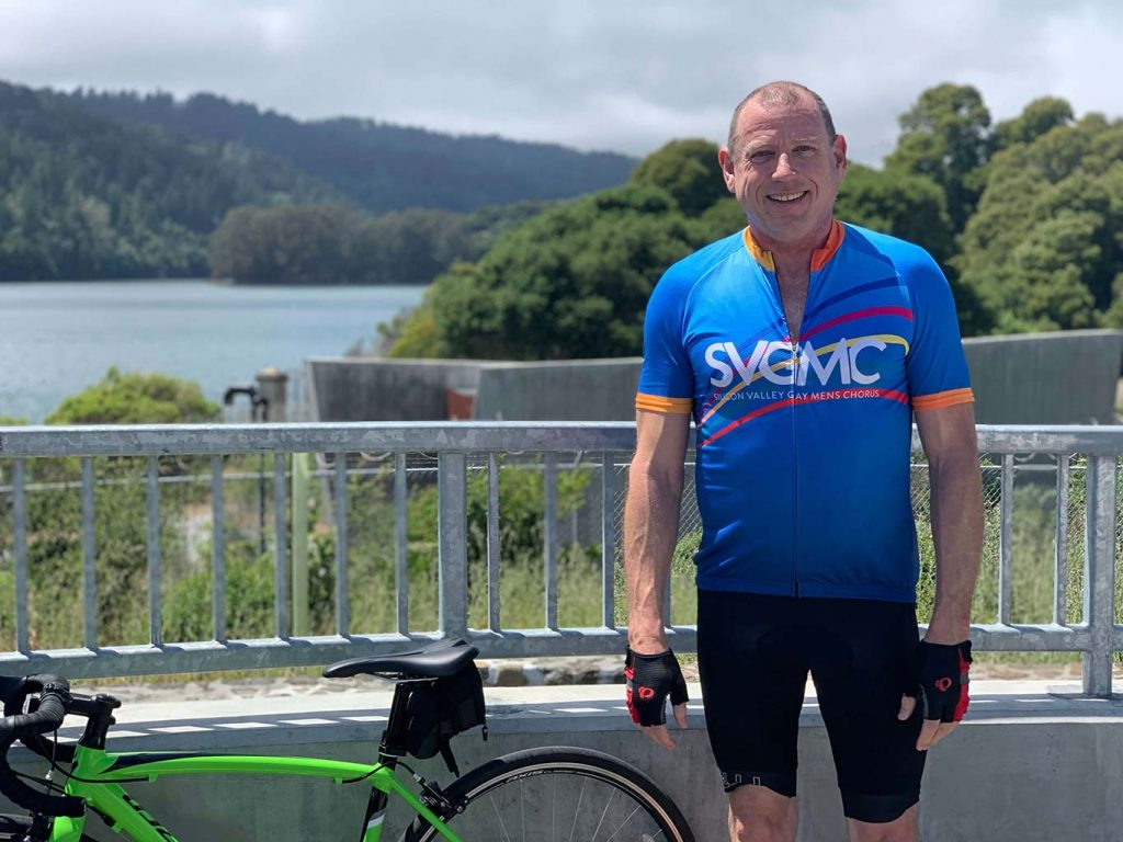 Doug McGrath, Male virtual personal training client standing near his bike