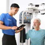 Male Personal Trainer and Male Client workout in studio