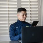 Male Personal Virtual Trainer on laptop