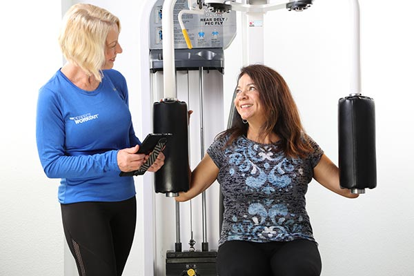 Female Personal Trainer with real female client