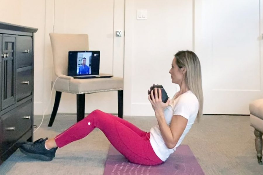 Virtual Personal Trainer coaching client at home